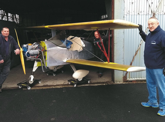 Aerosport Scamp is moved by Ulster Aviation Society volunteers