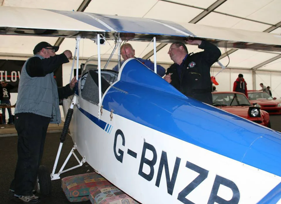 UAS Volunteers Harry Munn, Mal Deeley and Adrian prepare the little Clutton-Tabenor Fred Series 2 at a local car show