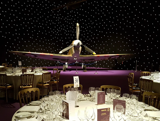 UAS Spitfire Mk2A Replica looking stunning in front of a starcloth during the RAF100 black-tie banquet at RIAT 2018