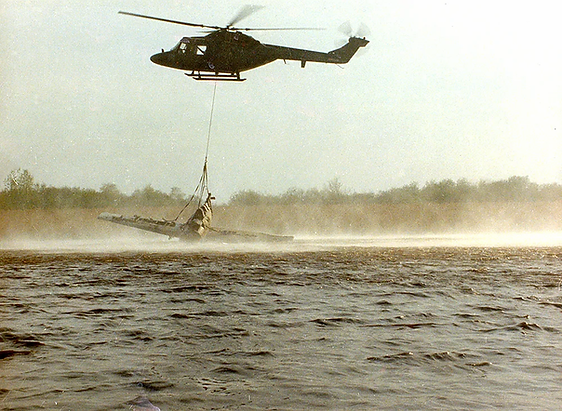 British Army Lynx lifting wreckage of Wildcat F4F JV482 out of the muddy waters of Portmore Lough, Northern Ireland, 1984