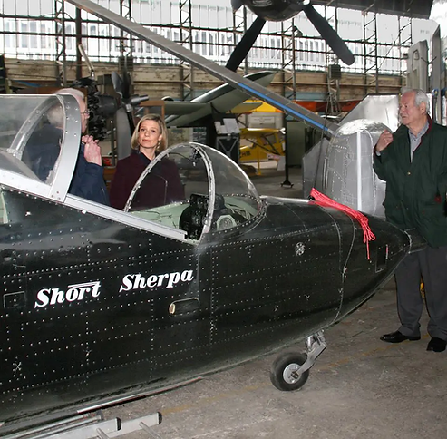 """Sarah Keith-Lucas talking to ex-Chairman of the UAS, Ernie Cromie during set-up for filming for BBC """"WEATHER WORLD"""""""