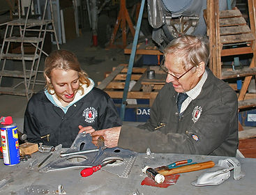 Volunteers working on restoring aircraft at the Ulster Aviation Society in Lisburn, Northern Ireland