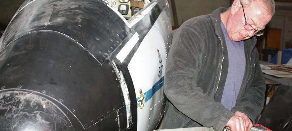UAS Volunteer Mal working on Devon C2 Cockpit