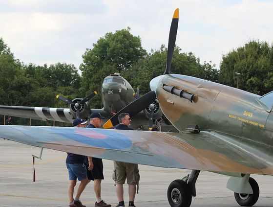"""Ulster Aviation Society volunteers at RIAT 2018 with the UAS Spitfire Replica MK2a """"Down"""""""