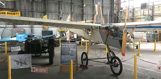 "Ferguson Flyer 1911 (Flying) Replica, seen on the three-part BBC documentary series ""The Great-Flying-Challenge"" during 2016, pictured here in the main Ulster Aviation Society' hangar with a Ferguson MK3 Tractor"