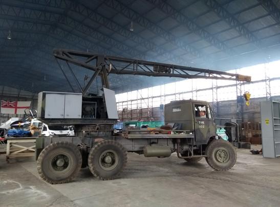 Hangar volunteer, Gary Millington moving the Thorneycroft Amazon Coles Crane into its new restoration spot in hangar 2 at the UAS