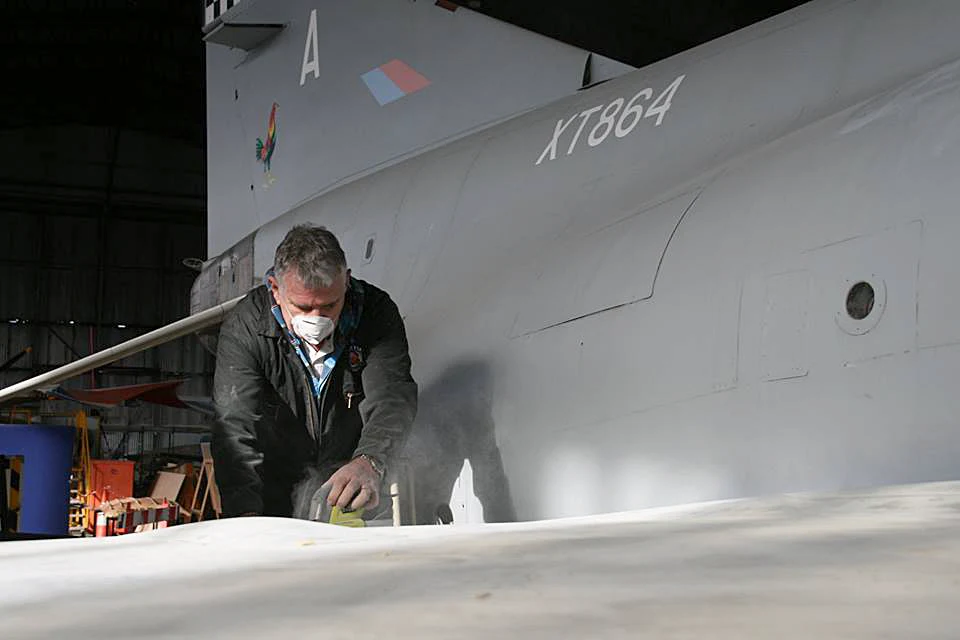 UAS member and hangar volunteer, Stephen Cunningham sanding down the wing surface (March 2017) on our Phantom FG.1