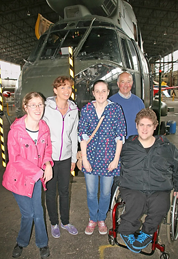 PAST VISITORS:  Members of the Cedar Foundation arrived     for a guided tour of the hangar in 2014.  UAS Tour Guide, Norman Watt (Back) escorted the group including (L~R): Laura Stevenson, Ashley Poole (training officer for Cedar), Susan Parkinson and Kyle McClure