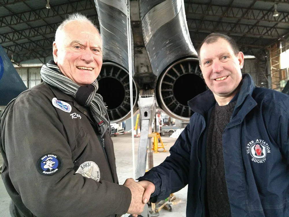 "UAS Chairman, Ray Burrows (left) congratulates Ulster Aviation Society' member and ex-RAF painter Ian Hendry on a job well done, after completing the spectacular new Fleet Air Arm paintjob on the Phantom FG.1 ""007"". Image: Alan Jarden"