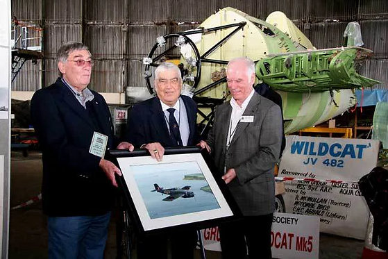 Original Wildcat JV482 pilot Peter Lock (left); Harry McKillop (centre) and Raymond Burrows, Chairman (right) pictured beside the aircraft at the UAS hangar