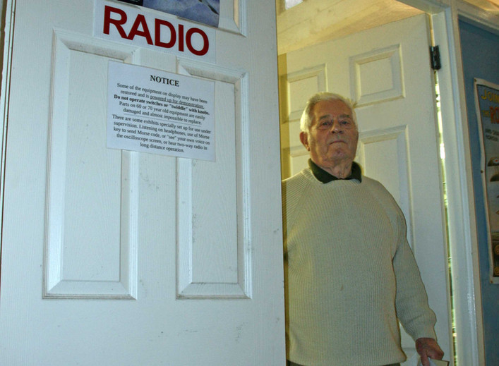 Fred Jennings outside his Radio Room at the Ulster Aviation Society hangars