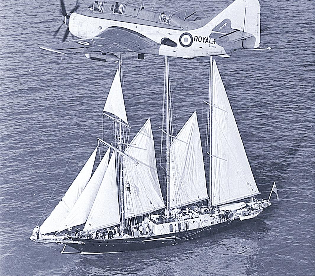 Fairey Gannet XA460 in its ECM.6 guise flying over the Sir Winston Churchill sailing ship