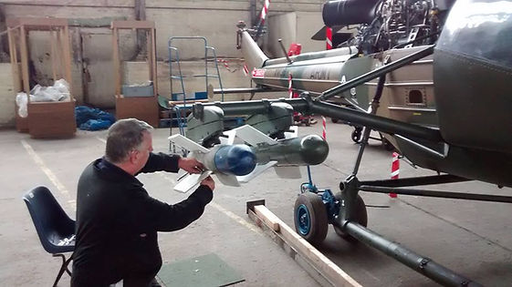 Hangar volunteer, Stephen Cunningham puts the finishing touches to the Westland Scout's starboard Missile mount at the Ulster Aviation Society
