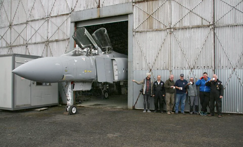 Society' volunteers posing for a group photo with the Phantom outside Hangar 2, during our 50th Anniversary Calendar 2018 shoot