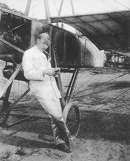 Harry Ferguson beside his original Ferguson Flyer in 1911