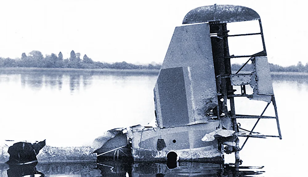 Tail Section Wreckage of Grumman Wildcat F4F JV482 lying in water and muddy depths of Portmore Lough, Northern Ireland