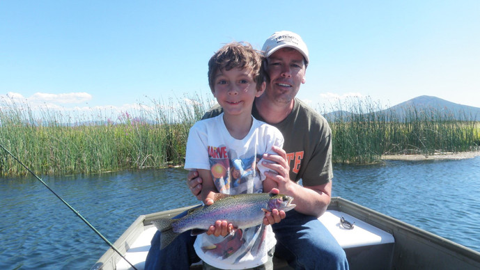 Father and son catch a fish