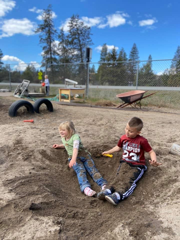 Children enjoying playing in the sand