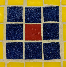 A mosaic with blue, red and yellow tile.