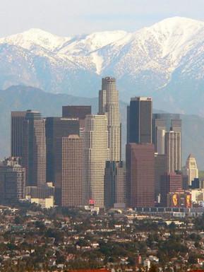The snow capped San Gabriel Mountains grace the LA sky line.