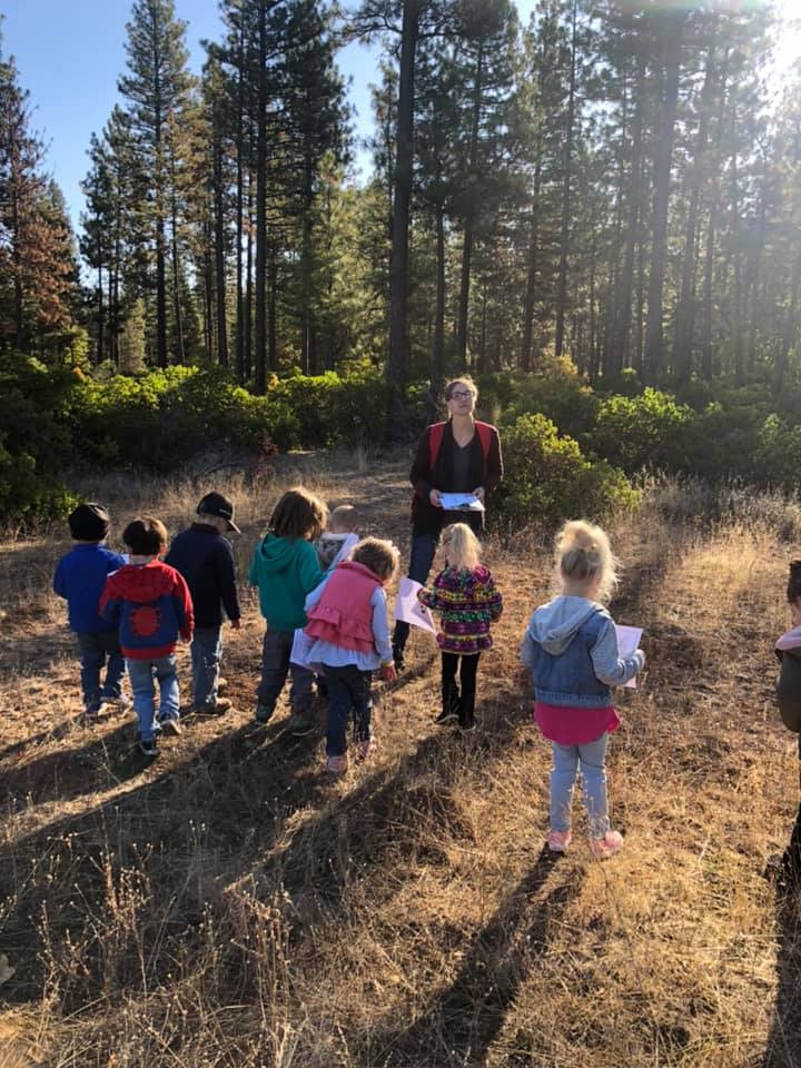 Children and their teacher learning outdoors