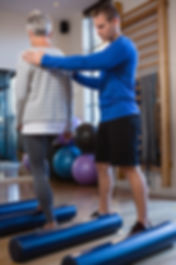 physiotherapist-assisting-senior-woman-i
