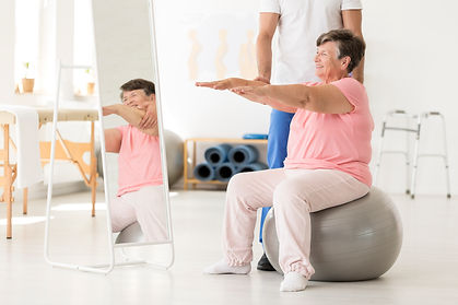senior-exercising-with-physiotherapist-P