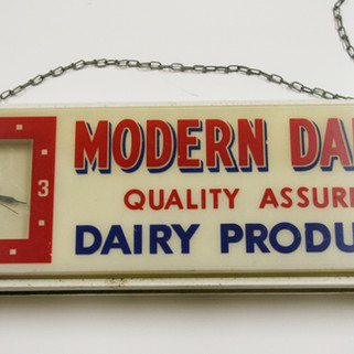 Modern Dairy lighted clock sign St. Marys PA