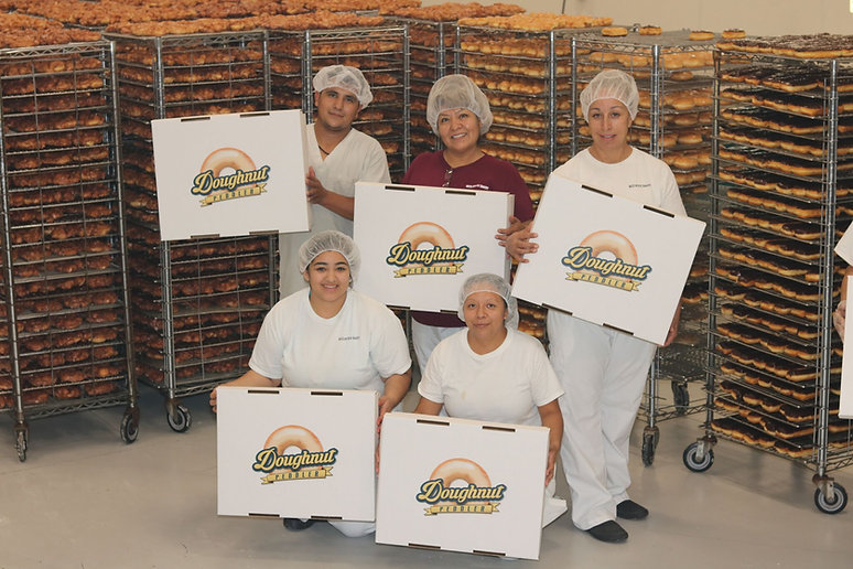 workers with boxes of doughnuts