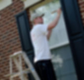 After the house has been prepared, student painters begin painting customers home