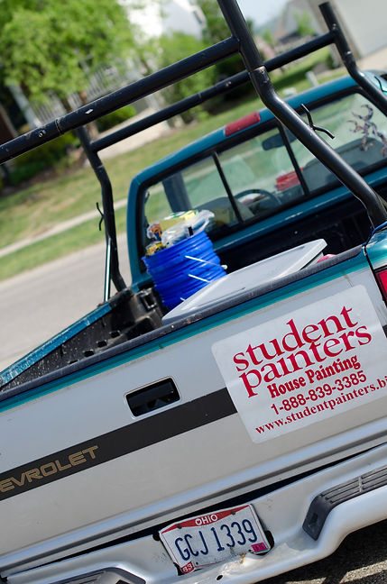 Lawn signs are used by student painters to advertise their businesses to the local community