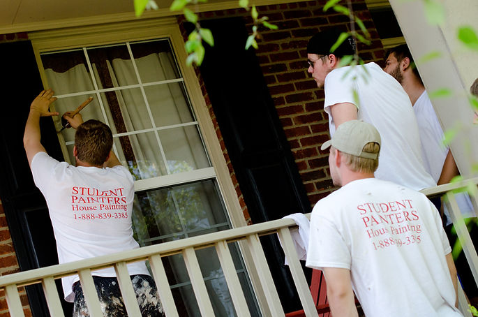 Painters putting the finishing touches on a customer's house