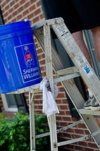 Sherwin Williams paint bucket sitting on safety certified ladder