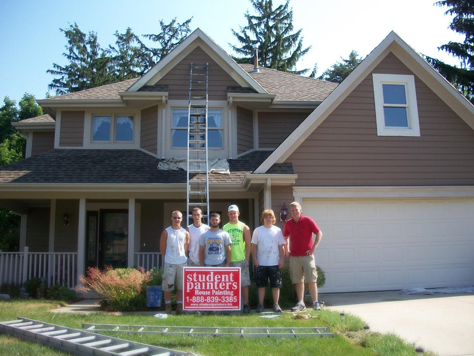 Photo of paint crew in front of customer's completed house