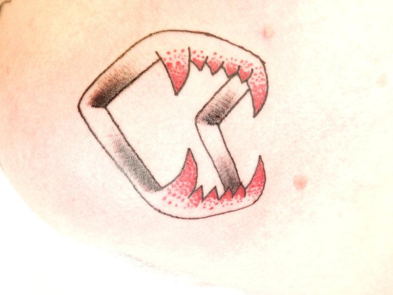 tattoo plastic fangs_edited.jpg