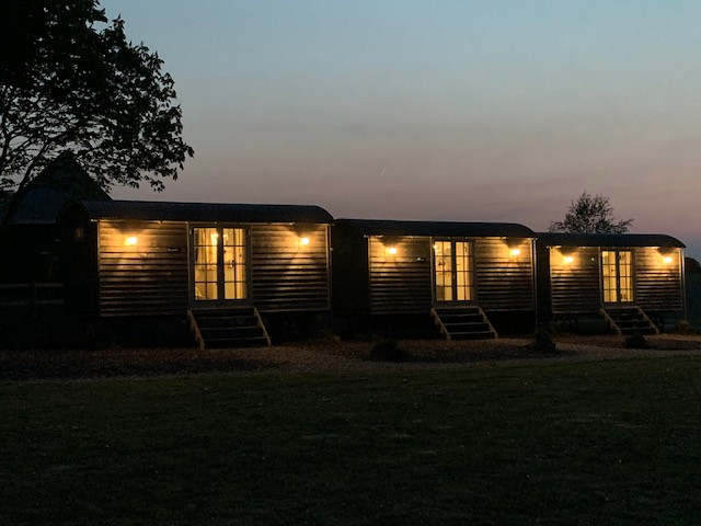 Shepherd's Huts at night