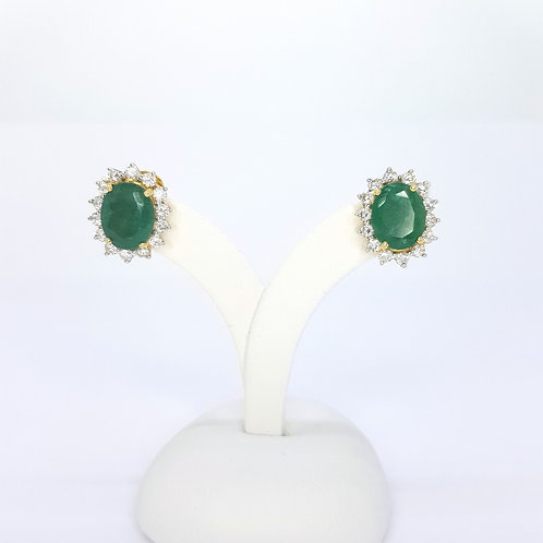 Emerald diamond cluster stud earrings.