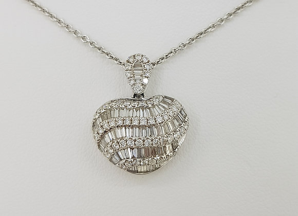 Baguette and brilliant cut diamond heart pendant.
