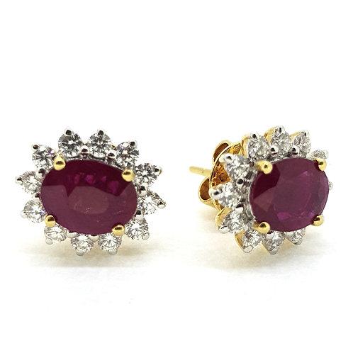 Ruby diamond cluster earrings.