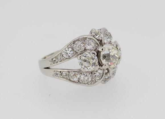 Diamond three stone cluster ring.