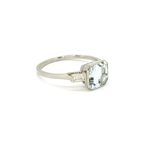 Aquamarine and baguette and diamond ring