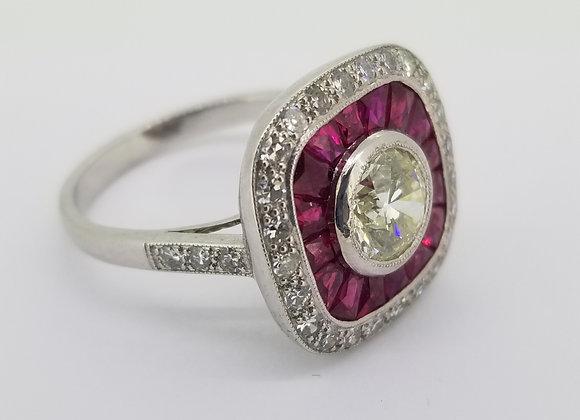 Ruby and diamond calibre set ring.