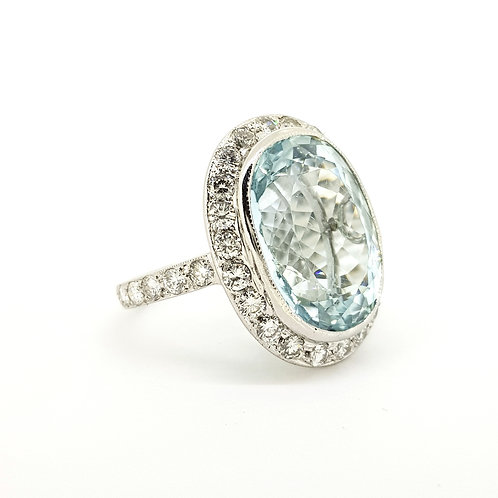 Aquamarine and diamond cluster ring. A22cts Est