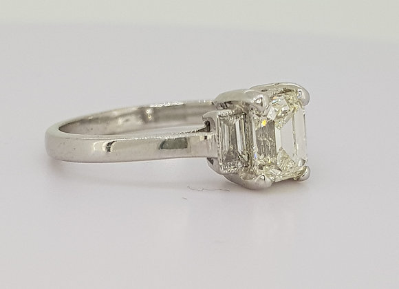 Emerald cut diamond ring with baguette shoulders.