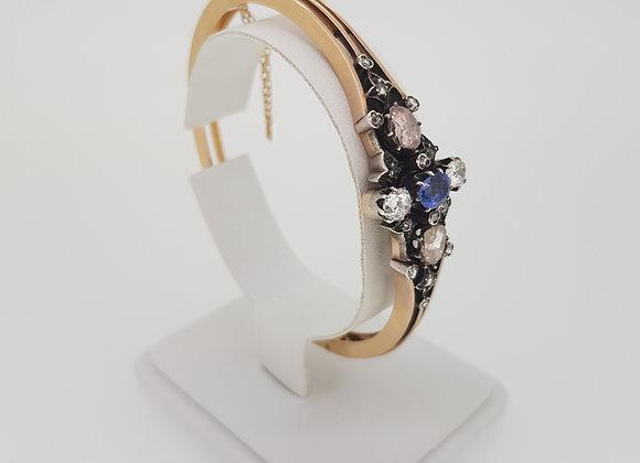 Sapphire and foil backed diamond bangle.