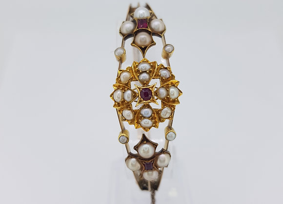 Edwardian pearl and ruby bangle.