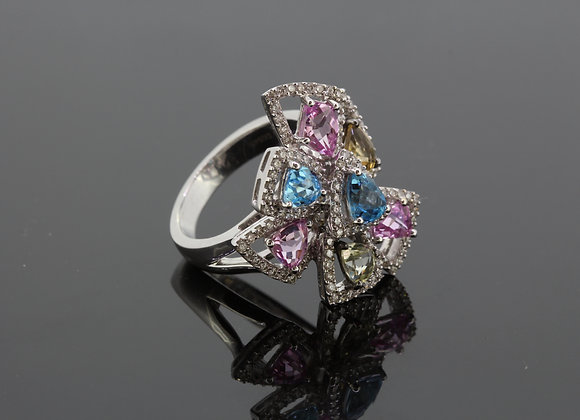 An abstract colored gemstone and diamond ring.