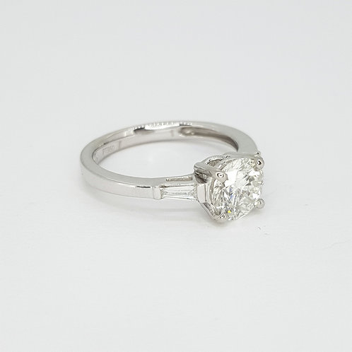 Solitaire diamond ring with baguette shoulders D1.09CTS X 0.15CTS Platinum