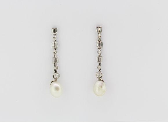Natural pearl and diamond earrings.