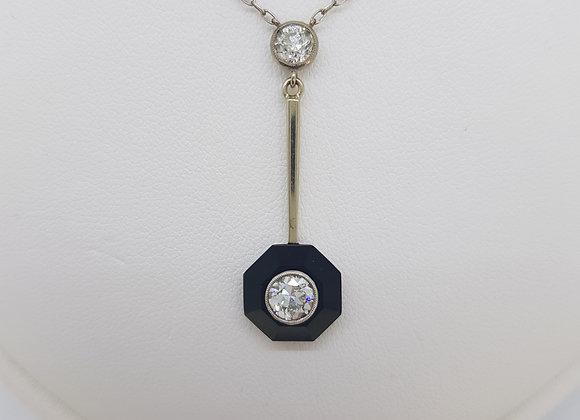 Antique onyx and diamond pendant